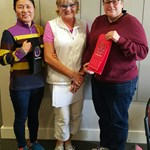 2016 Club Foursome Champions Young Mi Ko & Julie Crafter receiving Event Winner towels from Merrilyn Middleton